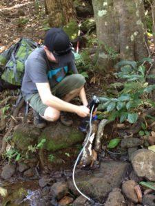Filtering water along Kalalau Trail